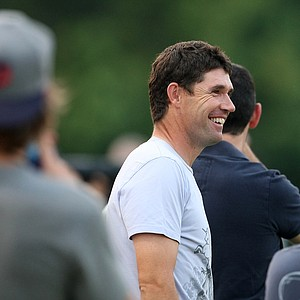 Golfer Padraig Harrington watches as fellow golfers Sergio Garcia, Alvaro Quiros, Nathan Green play soccer while at Davis Park for the Airmail Rovers FC.