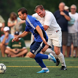 PGA Tour players, Sergio Garcia, center, played soccer Monday night for the Airmail Rovers FC during The Players Championship week at Davis Park.