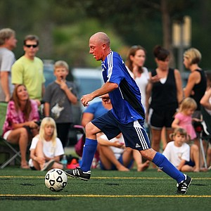 PGA Tour player Nathan Green takes the ball down field for the Airmail Rovers FC while at Davis Park on Monday night. Fellow golfers, Sergio Garcia and Alvaro Quiros also played.