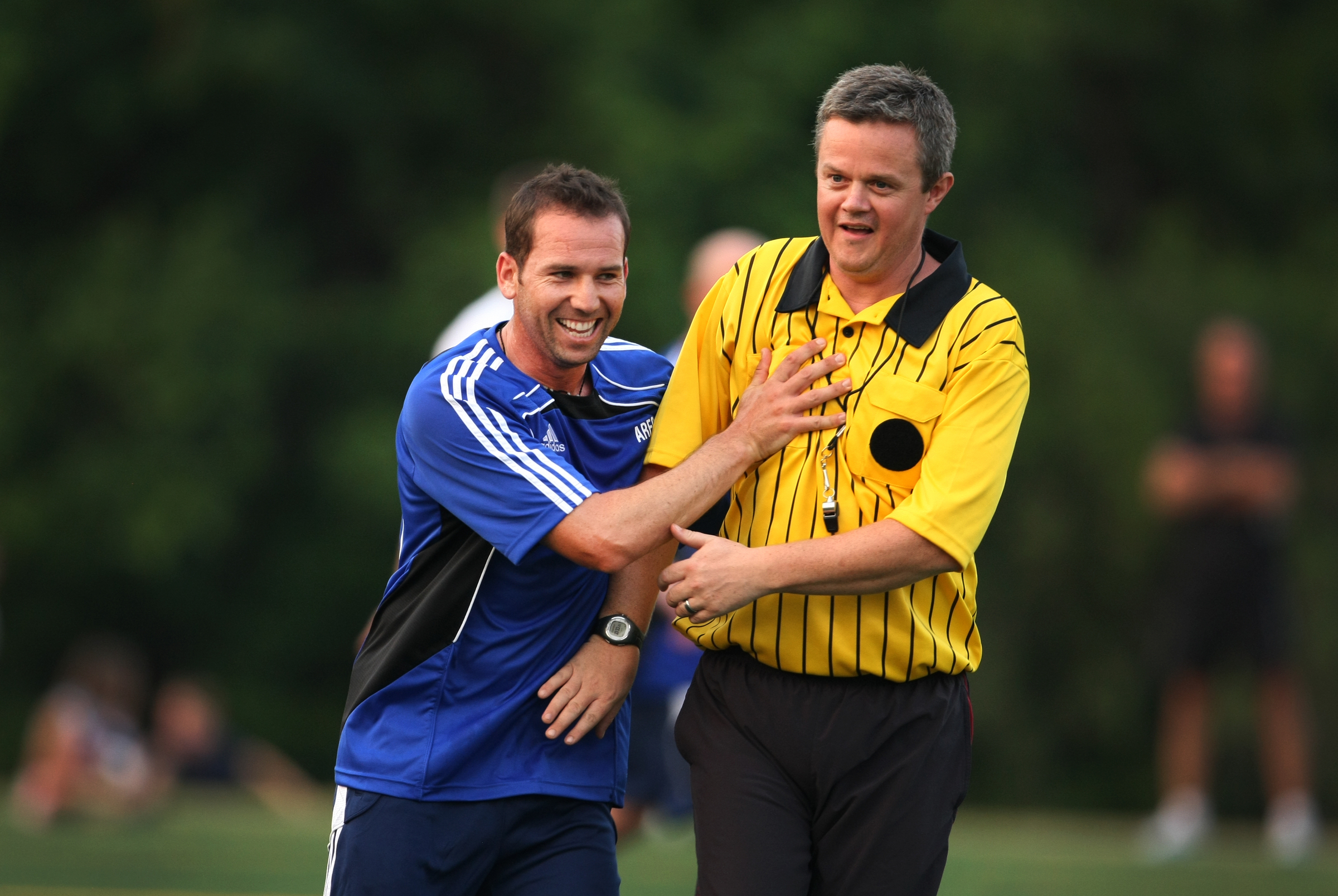 PGA Tour player, Sergio Garcia, jokes around with a referee while playing soccer for the Airmail Rovers FC at Davis Par on Monday night before The Players Championship.