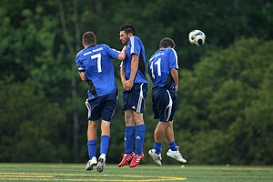 PGA Tour player Alvaro Quiros, center, played soccer with the Airmail Rovers FC at Davis Park on Monday night of the The Players Championship.