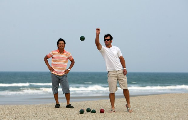 PGA Tour Players Paul Casey, right, bowls his Bocce ball while Ryuji Imada looks on during a friendly game on the beach at The Lodge and Club at Ponte Vedra Beach. For more exclusive videos from the PGA Tour, including Casey, Imada and Van Pelt, check out tourplayers.com, an exclusive partner of Golfweek.