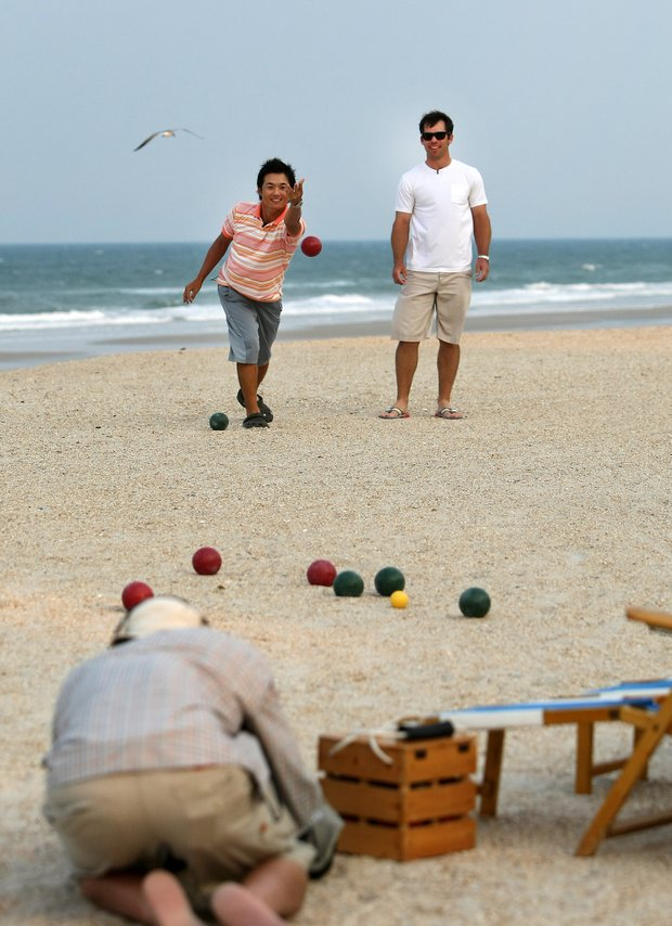 Ryuji Imada, left, bowls his Bocce ball as Paul Casey looks on while plalying a friendly game on the beach at The Lodge and Club at Ponte Vedra Beach. For more exclusive videos from the PGA Tour, including Casey, Imada and Van Pelt, check out tourplayers.com, an exclusive partner of Golfweek.