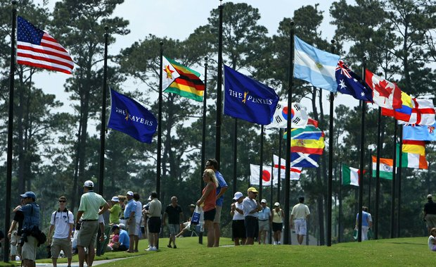 Fans gather around the driving range during Tuesday's practice round for The Players Championship at TPC Sawgrass.