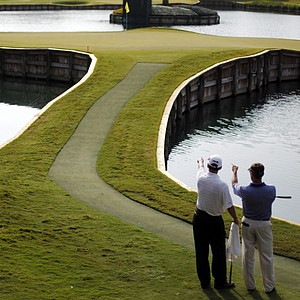 Brandt Jobe, right, and Kevin Sutherland survey the 17th green during the first round of The Players Championship.