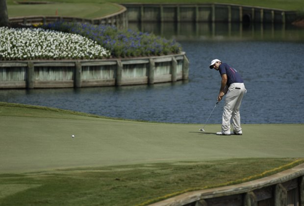 Jason Day putts on the 17th green during the first round of The Players Championship.