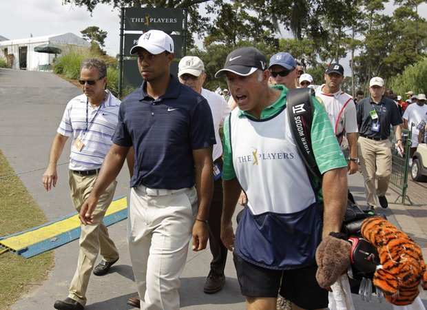Tiger Woods and his caddie Steve Williams leave the course after nine holes during the first round of The Players Championship. Woods withdrew after playing nine holes and shooting a 42.