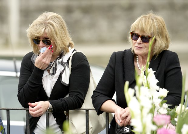 Fans cry as they attend Seve Ballesteros' funeral service in Pedrena, Spain, Wednesday May 11, 2011.