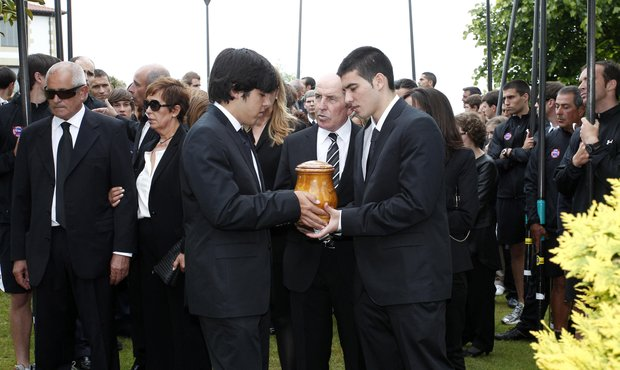 Javier Ballesteros (left) and Miquel Ballesteros (right) hold the urn containing the ashes of their father Seve Ballesteros on the premises of the family estate prior to the start of the funeral service held for the legendary Spanish golfer on May 11, 2011 in Pedrena, Spain.