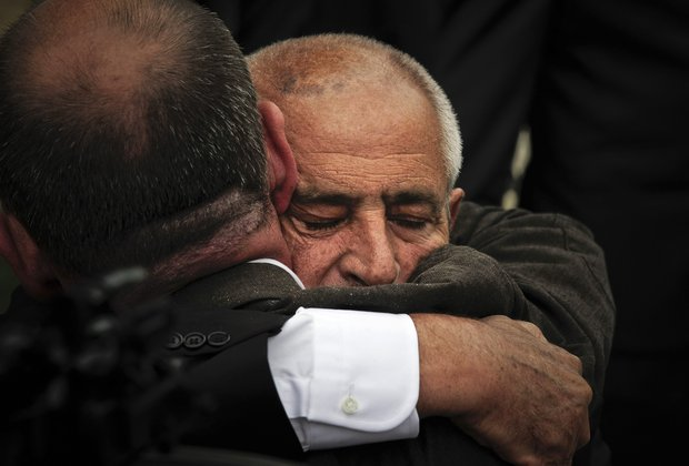 Ballesteros's brother, Baldomero, right, is comforted at the end of the funeral service of his brother, Spanish professional golfer Seve Ballesteros, in Pedrena, Spain, Wednesday May 11, 2011.