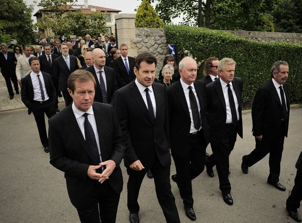 George O'Grady, head of the PGA European Tour, left, is seen with, from second left, international golfers Nick Faldo, an unidentified mourner, Colin Montgomerie and Sam Torrance as they leave Seve Ballesteros' house during the funeral service for Spanish professional golfer, Seve Ballesteros, in Pedrena, Spain, Wednesday May 11, 2011.