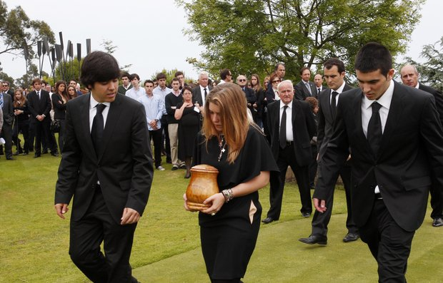 Carmen Ballesteros (centre) carries the urn containing the ashes of her father Seve Ballesteros in between her brothers Javier Ballesteros (left) and Miquel Ballesteros at the end of the funeral service held for the legendary Spanish golfer, on the family estate premises, on May 11, 2011 in Pedrena, Spain.