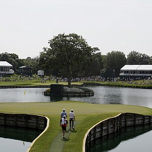 Aaron Baddeley, right, and Webb Simpson walk onto the 17th green.