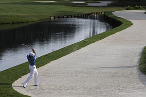 Gary Woodland plays out of a bunker on the 11th hole at TPC Sawgrass.