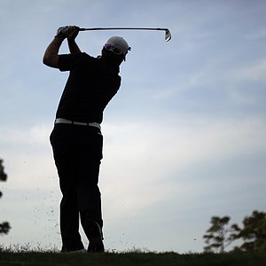 Graeme McDowell tees off for his second round at The Players Championship.