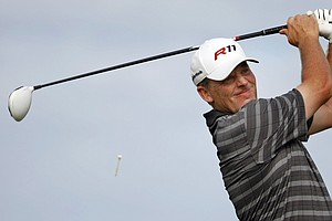 Michael Bradley watches his drive from the 18th tee during the final round of the 2011 Puerto Rico Open, where he defeated Troy Matteson in a one-hole playoff.