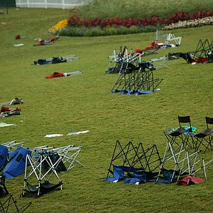 Empty chairs lay on the grass surrounding the 17th green during a rain delay on Saturday. Play resumed at 5:29 p.m.
