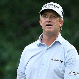 David Toms watches his tee shot at the fifth hole.