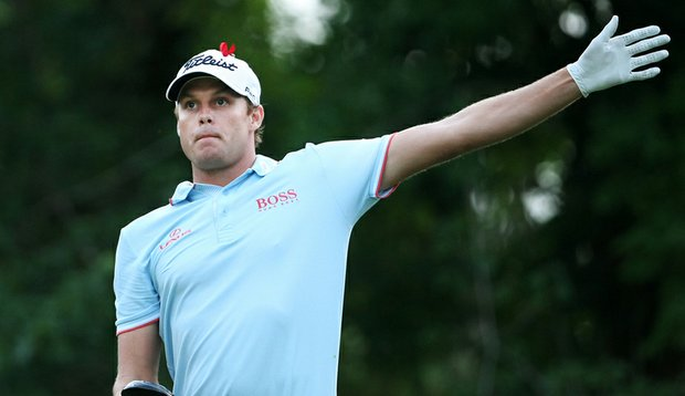 Nick Watney signals his ball is headed left during Round 3 of The Players Championship.