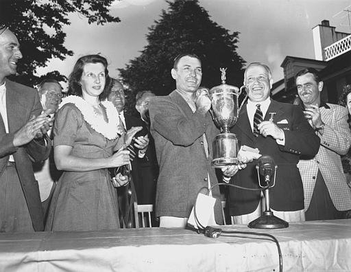 Ben Hogan his trophy after winning the 1950 U.S. Open Championship at Ardmore, Pa. on June 11, 1950. Standing beside him to the right is Jame D. Standish, Jr., president of the U.S. Golf Association, and Hogan's wife Valerie, left.