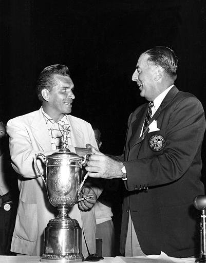 Julius Boros, left, is presented the trophy by Totten P. Heffelfinger, President of the U.S. Golf Association, after winning the 1952 U.S. Open Golf Championship, at Northwood Club in Dallas, Texas, on June 14, 1952. Boros put together rounds of 71, 71, 68, and 71 to post his winning 181 total.