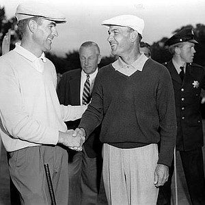 Ben Hogan, right, congratulates Jack Fleck, who beat Hogan by three strokes in an 18 hole playoff at the Olympic Club, Lake Course, in San Francisco, Ca., on June 19, 1955. The man in center, rear, is Isaac Grainer, president of the U.S. Golf Association.