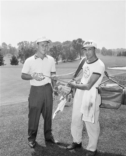 Arnold Palmer, left, who shot a 67 in practice round for the 1956 U.S. Open Golf at Rochester, New York is shown with his caddy, Joe Cambisi after a round.