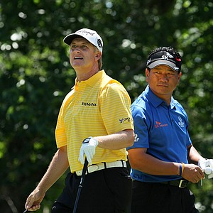 David Toms watches his tee shot at No. 5 while K.J. Choi prepares to hit on Sunday during the final round of the The Players Championship.