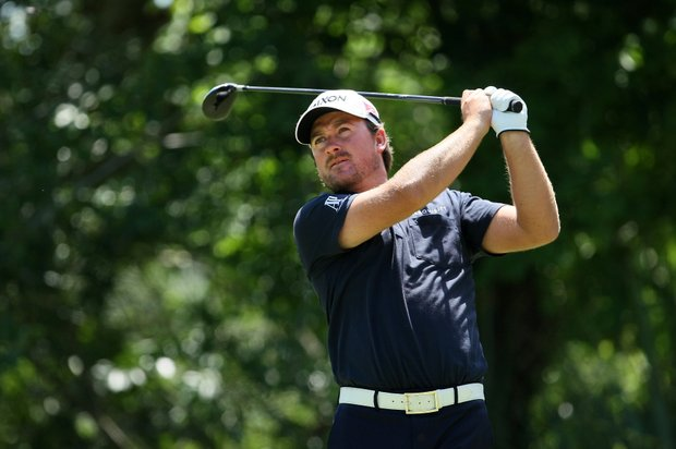 Graeme McDowell hits his tee shot at No. 5 during the final round of the The Players Championship.