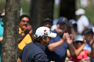 Graeme McDowell reacts at the fifth green during the final round of The Players Championship.