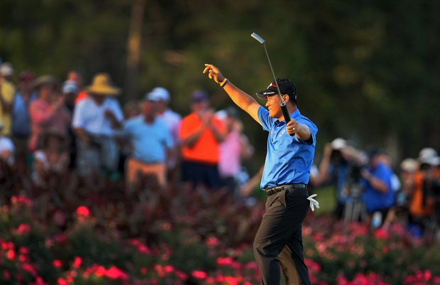K. J. Choi pumps his fist after defeating David Toms in a playoff at No. 17.