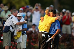 David Toms and K. J. Choi hug at No. 17 after Choi defeated Toms in a playoff.
