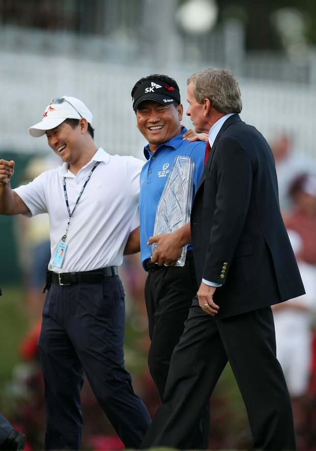 K. J. Choi, center, shares a laugh with his mananger, Michael Yim, left, and PGA Tour Commisioner Tim Finchem  at No. 17.