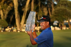 K. J. Choi with the trophy at No. 18. Choi defeated David Toms in a playoff.