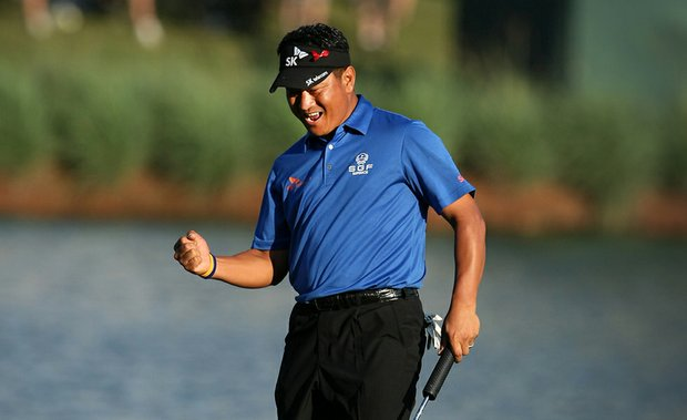 K.J. Choi pumps his fist after sinking a birdie putt on the 17th hole at The Players.