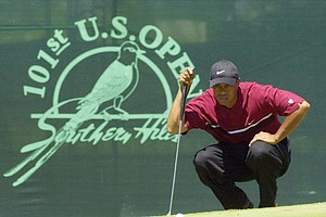 Tiger Woods lines up a putt on the 11th green during the final round of the U.S. Open at Southern Hills Country Club in Tulsa, Okla., Sunday, June 17, 2001.