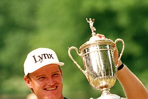 Ernie Els holds up his trophy after winning the US Open golf tournament in Oakmont, Pa., in this June 20, 1994 file photo.