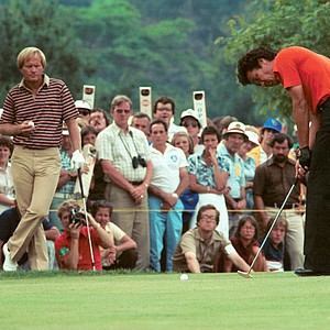 Isao Aoki of Japan putts on the green as Jack Nicklaus looks on, during the final round of the 80th U.S. Open Championship at Baltusrol Golf Club in Springfield, N.J., Sunday, June 15, 1980.
