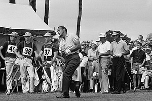 Arnold Palmer Ligonier, Pa., winner of the U.S. Open golf championship in 1960, watches flight of his tee shot on first hole at The Country Club, June 20, 1963 in Brookline, Mass., at start of the 1963 USGA Open. Playing in threesome with Palmer are Jay Hebert, right, of Lafayette, La., and Doug Ford of Brookville, N.Y.