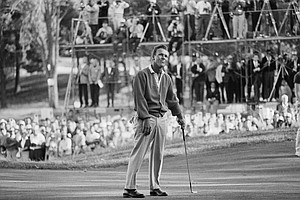 Arnold Palmer responds in the usual Palmer manner to his birdie putt on the 16th at The Country Club in Brookline, Mass., June 22, 1963, in final round of the U.S. Open golf championship. Palmer, Julius Boros and Jacky Cupit were all tied up for the title and will play an 18-hole playoff match here tomorrow