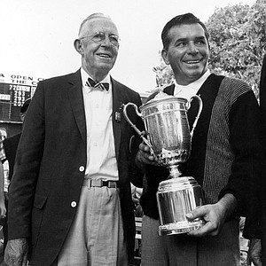 Julius Boros, right, poses with the trophy, after winning the U.S. Open Golf Championship, at the Country Club in Brookline, Mass., on June 23, 1963. Next to him stands Francis Ouimet, former U.S. Open champion and honorary chairman of the tournament