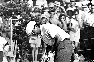 Ken Venturi makes the final putt on the 18th green during the U.S. Open Golf Championship at the Congressional Country Club course in Bethesda, Md., on June 20, 1964. Despite suffering from severe dehydration and exhaustion due to the 100-degree heat, Venturi went to win the event with a score of 278.