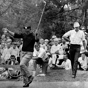 Lee Trevino reacts to a birdie putt on the 11th hole in third round of the 68th U.S. Open golf championship at Oak Hill Country Club in Rochester, N.Y., June 15, 1968. Leader at the halfway mark is Bert Yancey, standing at right.