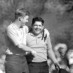 Lee Trevino is congratulated by Bert Yancey on the 18th green after sinking his final putt for a 4 and a 69 to win the 68th U.S. Open golf championship at Oak Hill Country Club in Rochester, N.Y., June 16, 1968. Yancey had been the leader for three rounds. It was Trevino's fourth consecutive sub-par round.