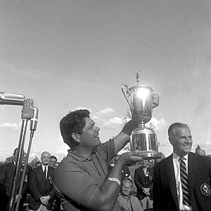 Lee Trevino holds his trophy cup after winning the title of the 68th U.S. Open golf championship at Oak Hill Country Club in Rochester, N.Y., June 16, 1968. His four sub-par rounds of 69-68-69-69 tied the U.S. Open record of 275.