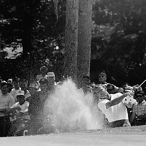 Arnold Palmer of Ligonier, Pa., right, sends sand flying as he blasts from trap near the 4th green in the opening round of the U. S. Open Championship, June 12, 1969, Houston, Tex.