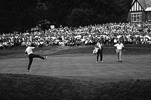 Jack Nicklaus kicks his leg after sinking a birdie putt on the 18th hole to win the U.S. Open Golf Championship, June 18, 1967, in Springfield, N.J. At right is runner up, Arnold Palmer.