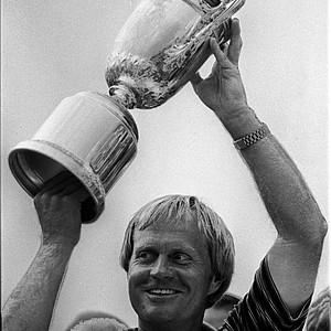 Jack Nicklaus smiles as he holds up his fourth U.S. Open trophy, June 15, 1980, in Springfield, N.J.
