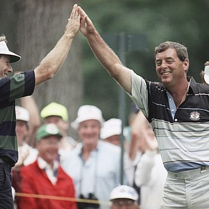 Fuzzy Zoeller of Floyds Knobs, Ind. right, gets a high five from playing partner Bernhard Langer after getting a hole-in-one on the 194-yard, par-3 fourth hole during the second round of the U.S. Open in Chaska, Minn., Friday, June 14, 1991.