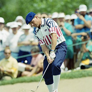 Payne Stewart watches his shot from the trap on the first green in Monday, June 17, 1991 playoff round of the U.S. Open Golf Championship in Chaska, Minn.